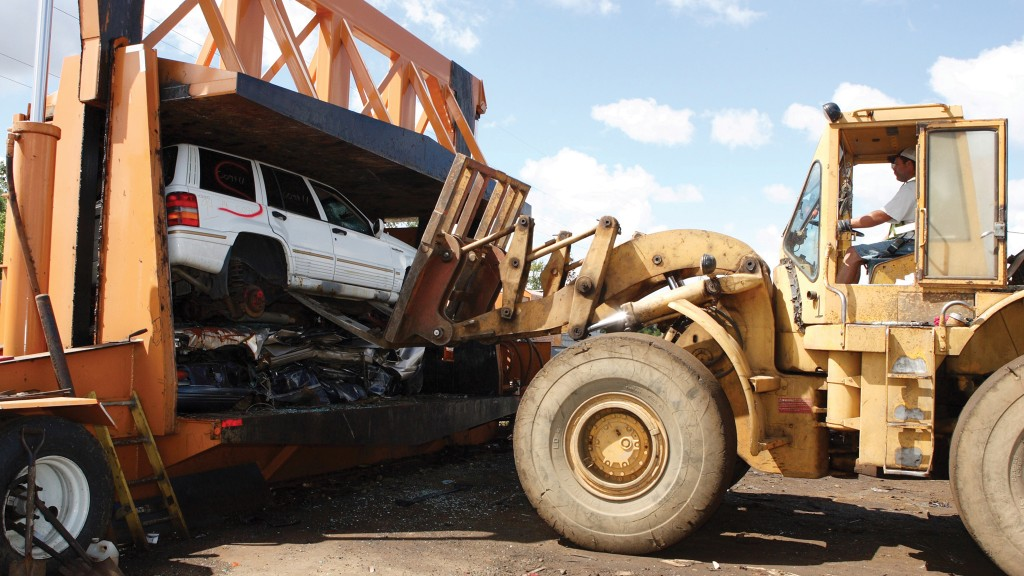 Auto recycling car loading into baler