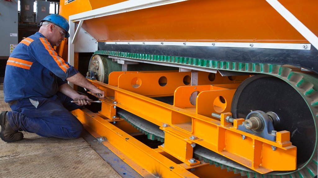 Worker performs maintenance on Eriez equipment.