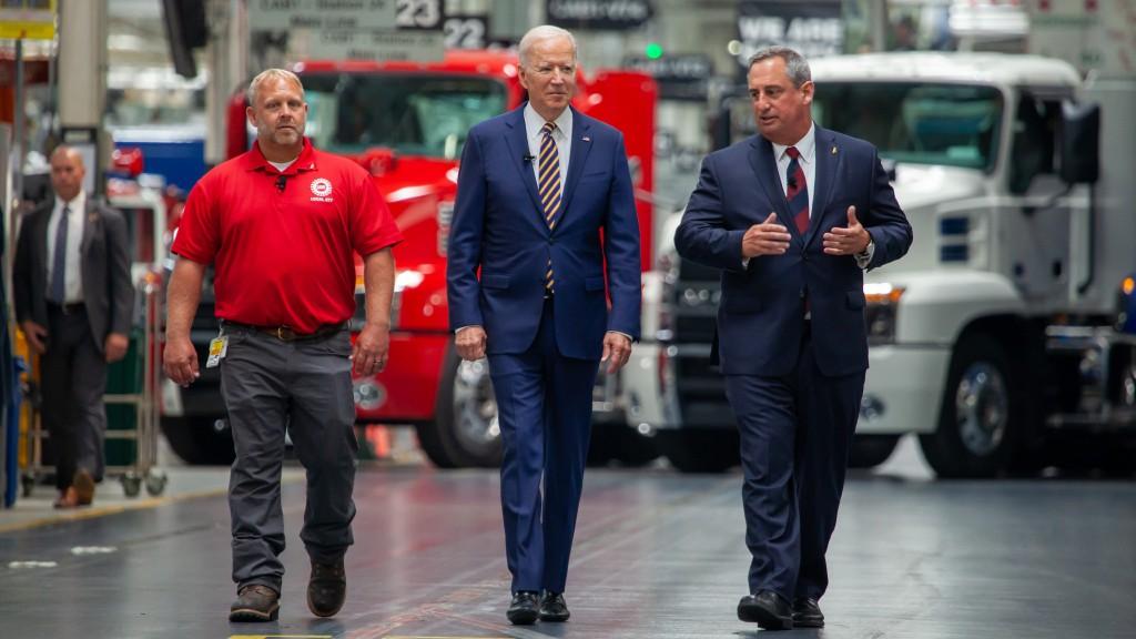 Biden and Mack Truck employees walking through Mack's facility.