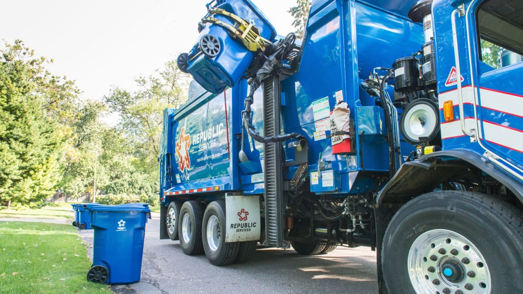A collection truck collects residential recycling