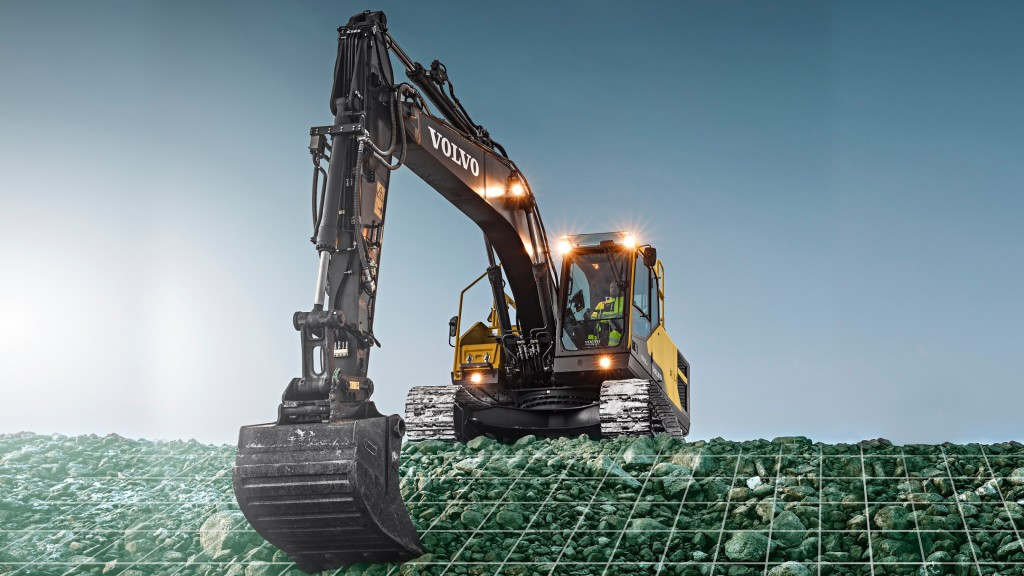 An excavator digs into small rocks
