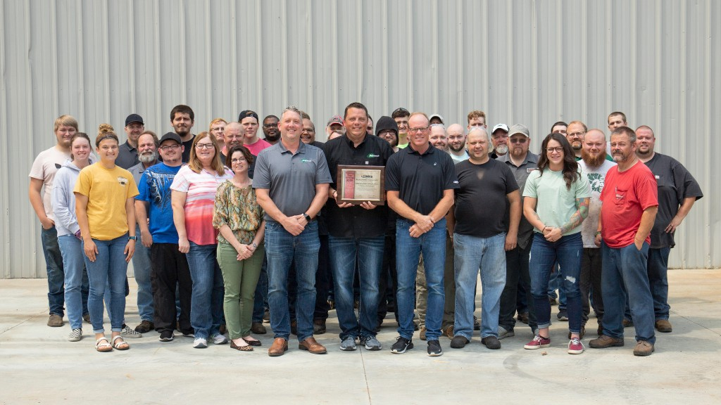 Minnich employees pose for an award photo
