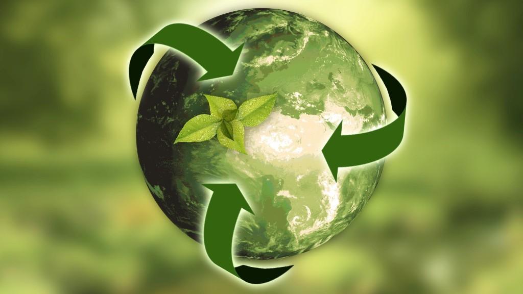 Arrows depict a circular economy around a green earth.