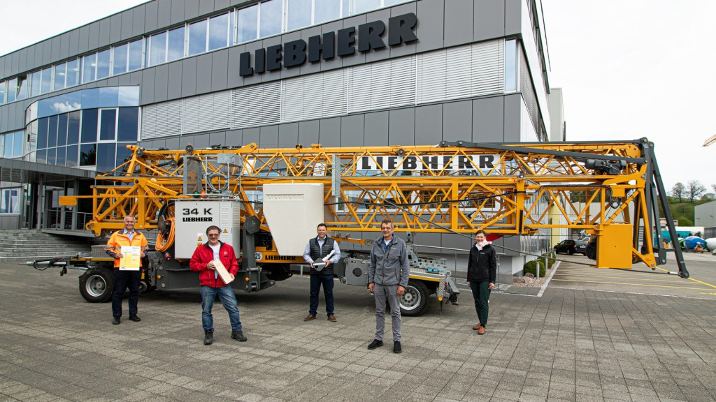 Liebherr and Mathis Bau emplyess stand by a 34 K fast-erecting crane