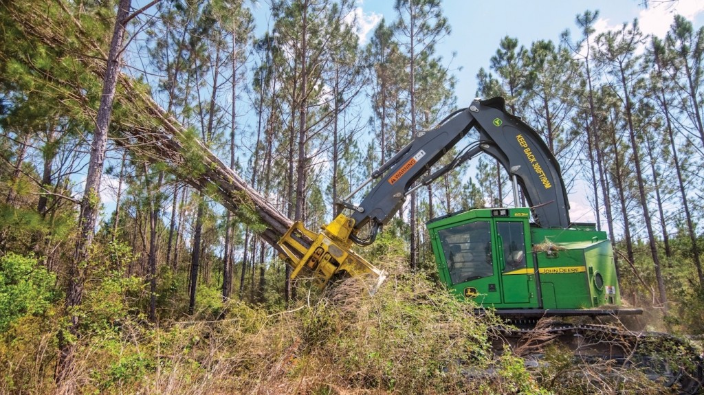 An 853M forestry machine felling trees.