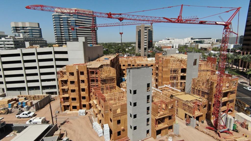 Two potain cranes in a close-quarter city construction