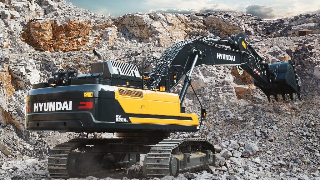 A Hyundai excavator digs on the job site