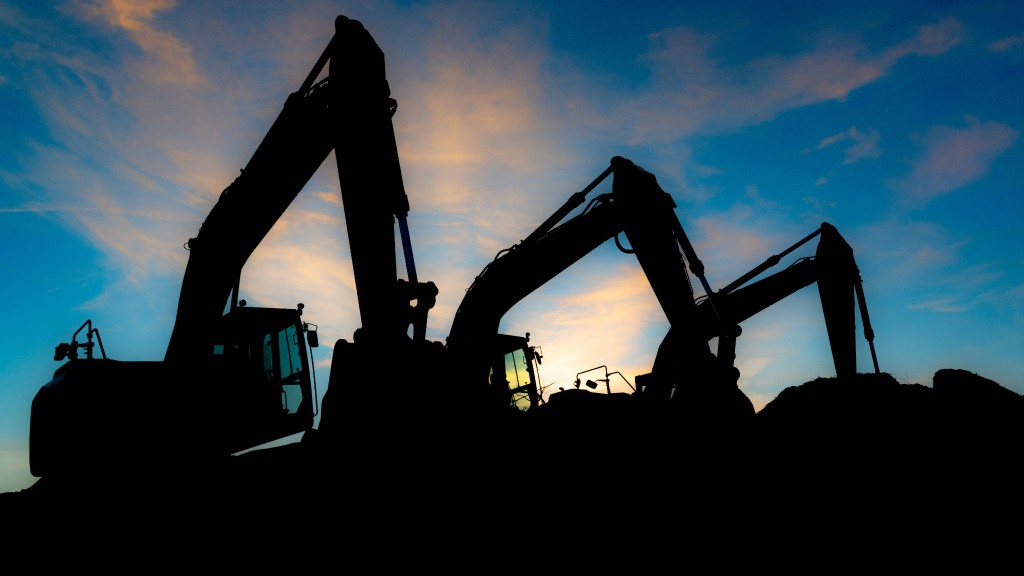 Excavator silhouetted across the skyline.