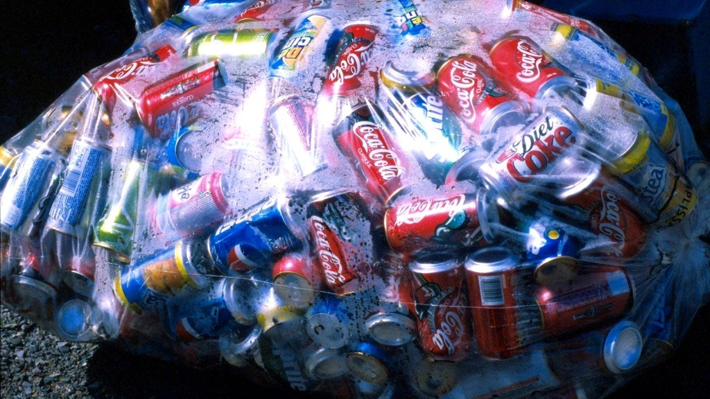 A plastic bag filled with aluminum cans