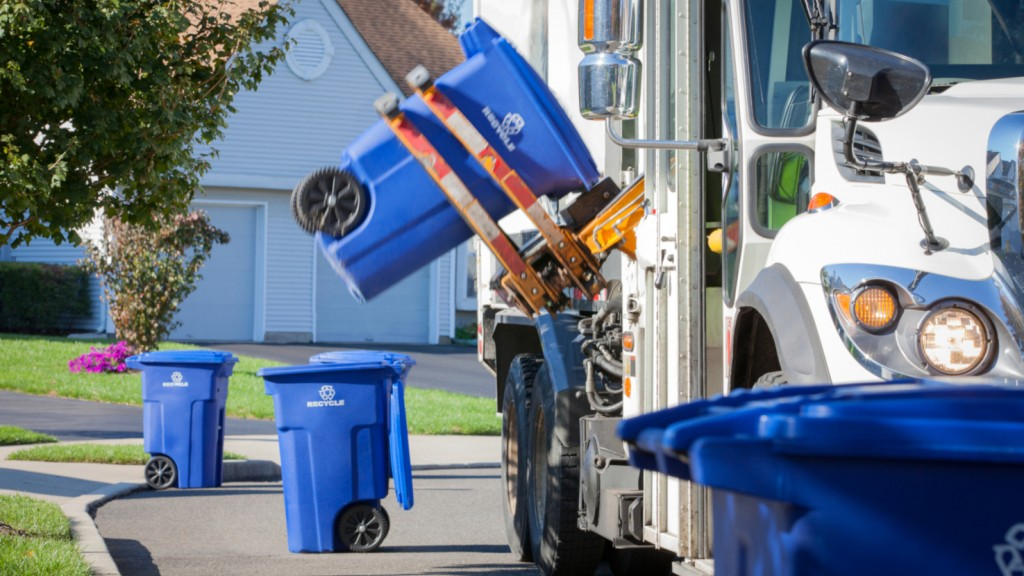 A collection truck collects curbside recycling