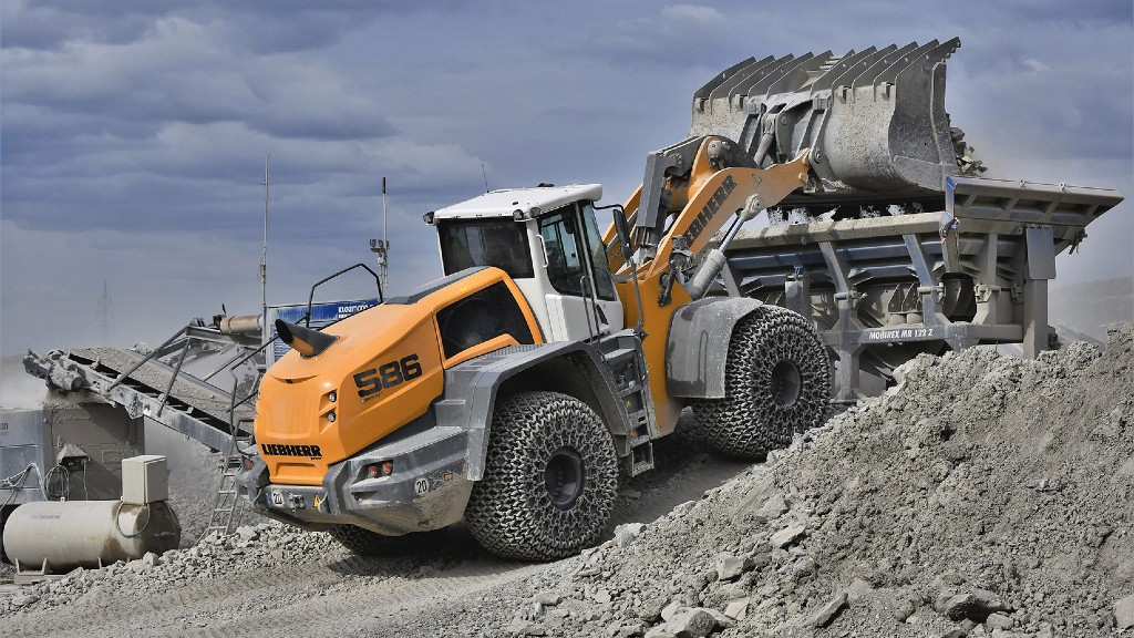 A Liebherr wheel loader loading a crusher on the job site