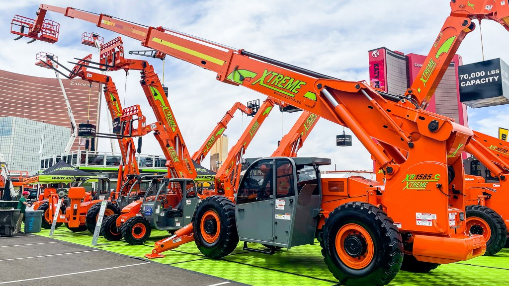 Fixed boom handlers parked at a trade display