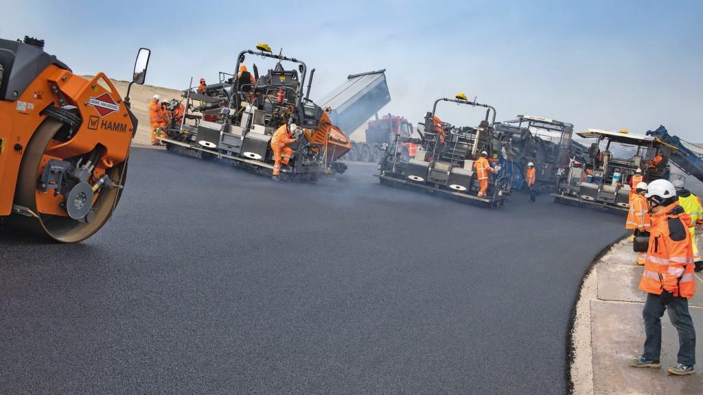 Asphalt pavers deployed on a grand prix race course