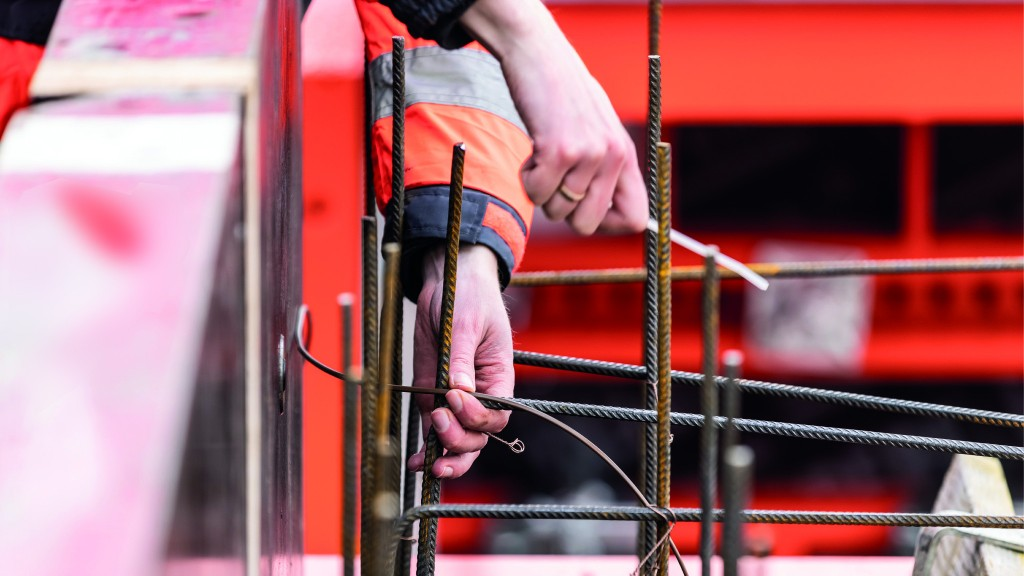 A worker installs a temperatuer sensor cable