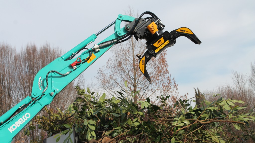 An MB Crusher grapple attached to a Kobelco excavator