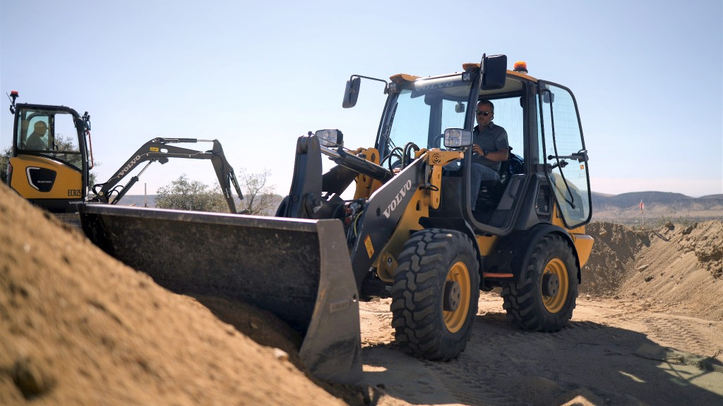 Volvo CE electric compact wheel loader and compact excavator working in California