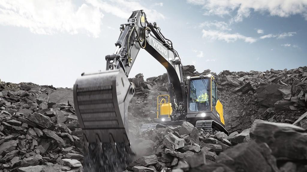 Volvo excavator moving large rock