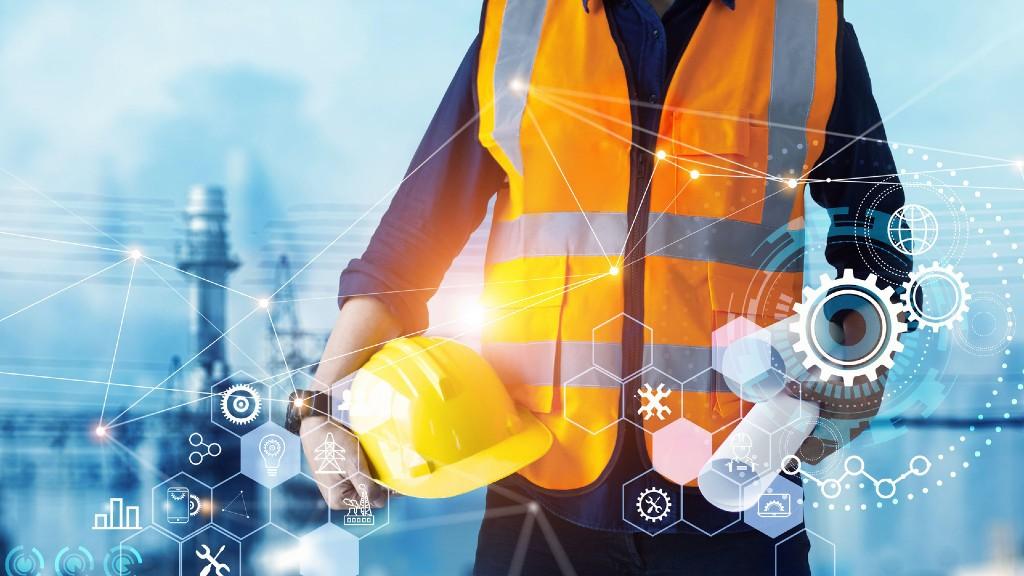 Worker in hi-vis vest among smart technology images