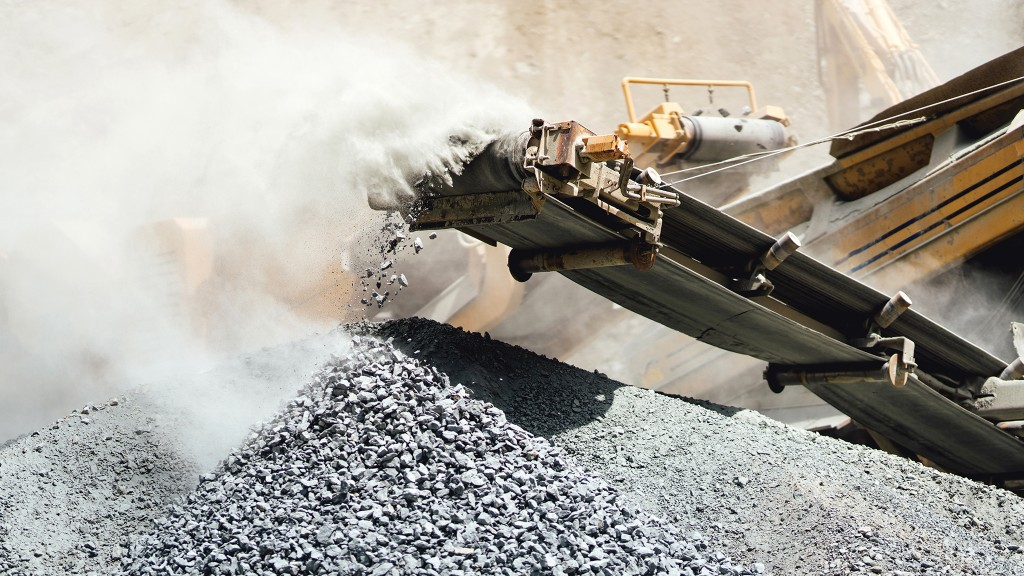 Crushed rock falling from crusher conveyors