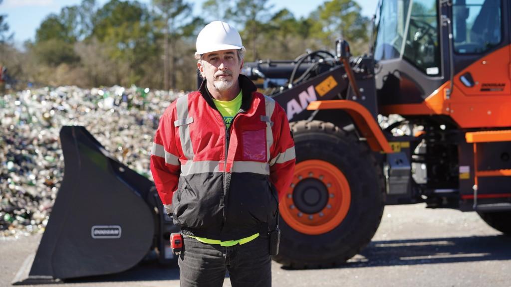 Brad Graham of GlassWRX, in front of his new Doosan DL220-5 wheel loader.