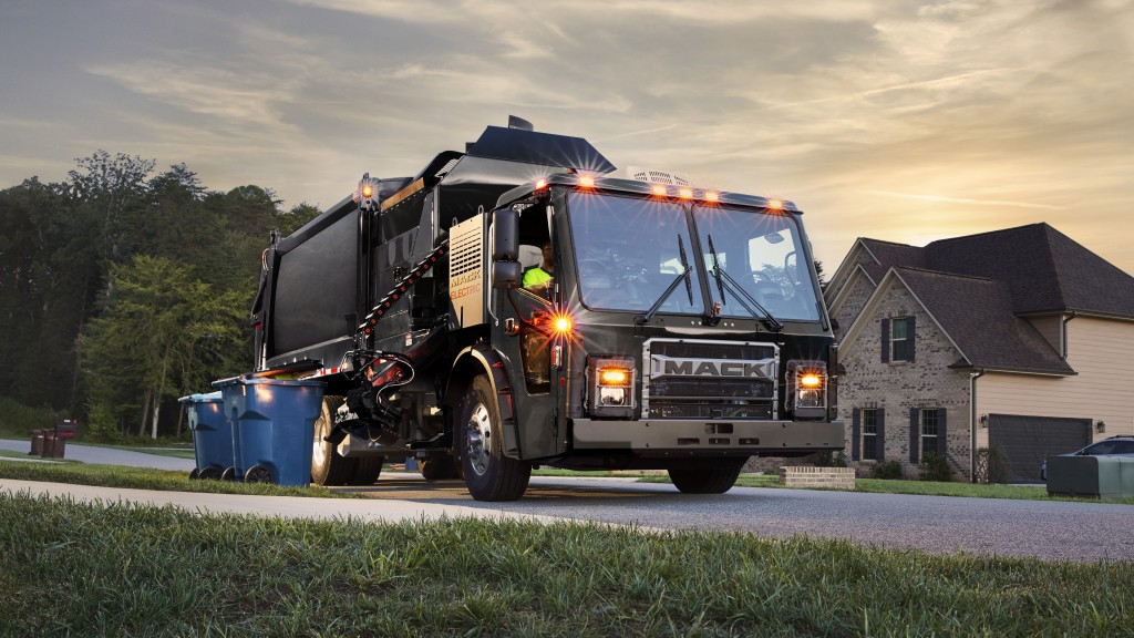 A Mack LR Electric collecting curbside waste