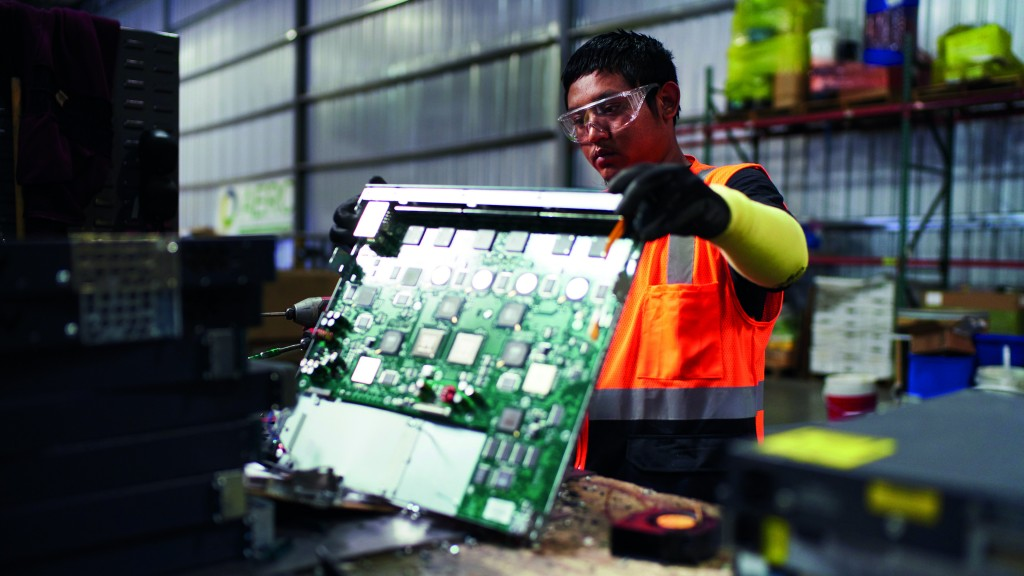 A worker handles a circuit board