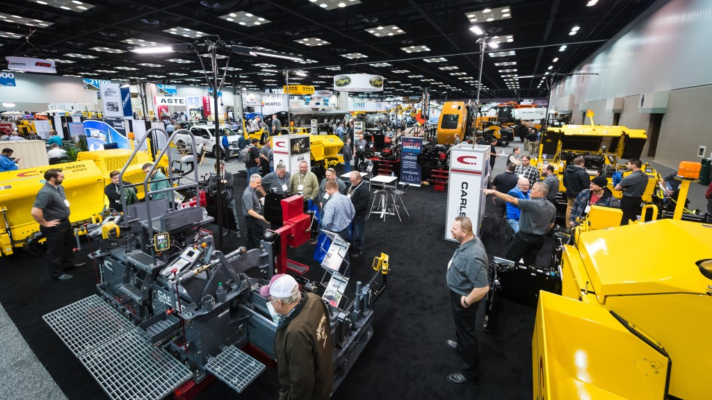 Patrons walk and interact around the World of Asphalt show floor