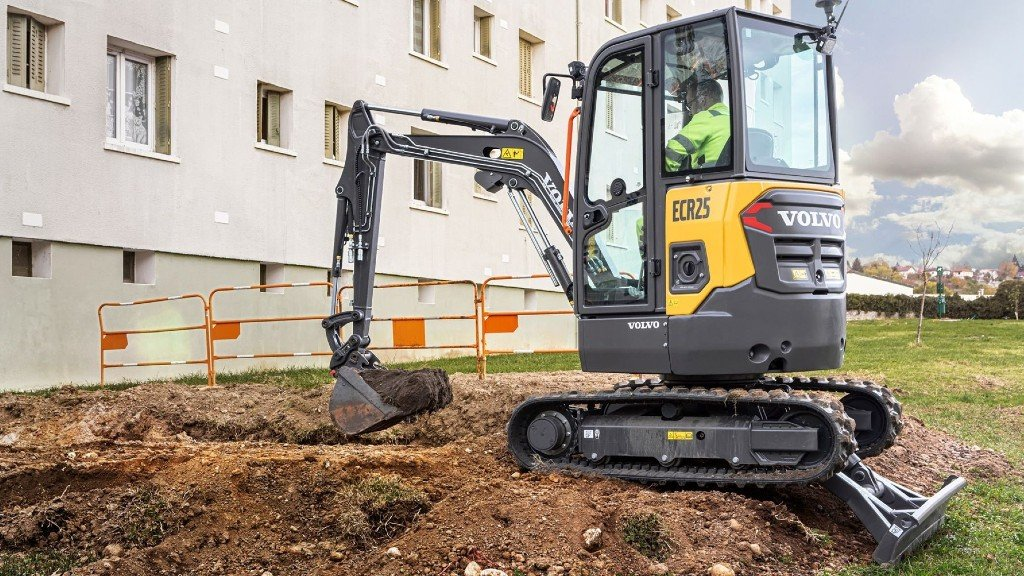 A compact electric excavator on the job site