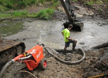SV60 transferring muck and rock at a construction site.