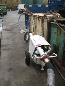 SV60 transferring mud from skip to tank with zero discharge environmental control.