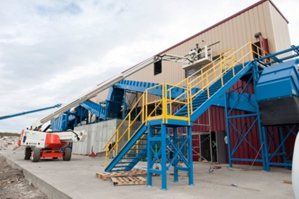Edmonton's C&D facility, built by New Brunswick-based Sparta Innovations, uses a double vibratory finger screen, which splits material into three material streams.