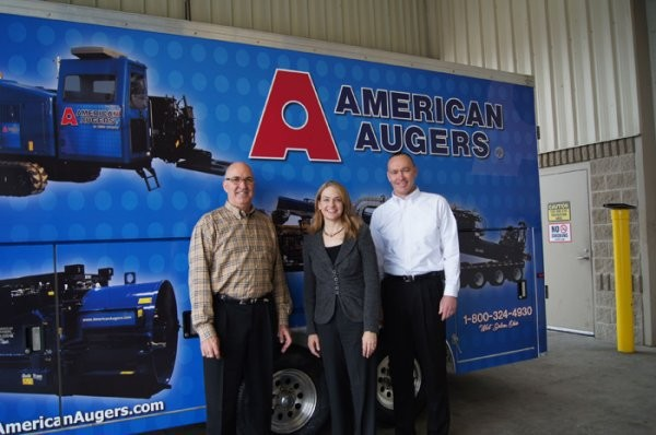 (front left to right)  Rick Johnson, CMW's Chief Operating Officer, Tiffany Sewell-Howard, CMW's Chief Executive Officer, and David Hammonds, American Augers General Manager.