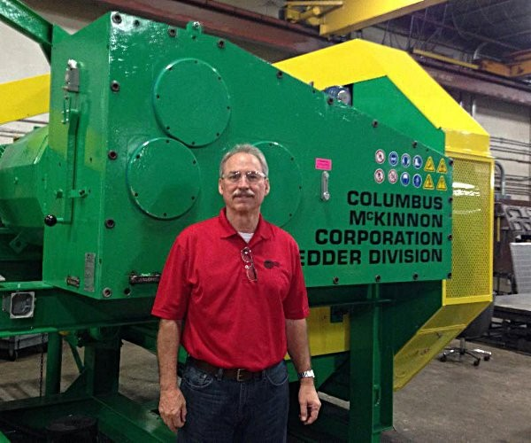 Robert Perron, President of GWC, standing with the CM Dual Speed Tire Shredder during a  recent visit to the CM factory in Sarasota, Florida