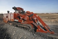Large-track trencher digs in both rock and dirt