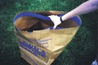 Yard waste bag accessory relieves frustration