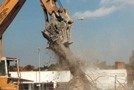 Concrete crusher also removes and cuts rebar