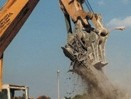 Concrete crusher removes and cuts rebar
