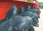 Mulcher attachments for skid-steer loaders