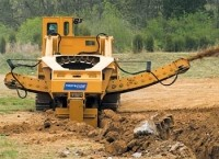 Wheel trencher digs to nine feet deep