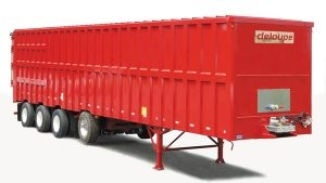 Tapered trailer with self-unloading floor