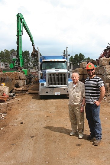 Ian Weinstein and his grandfather George, the 2nd and fourth generation of the family business, at Allied Salvage and Metals' Richmond, B.C. yard.