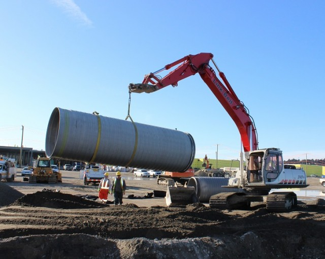 Delivered from the recently opened ADS distribution yard in Abbotsford, a 6-meter (20-foot) long section of large diameter SaniTite HP pipe is moved into place for a nearby mega-mall project.