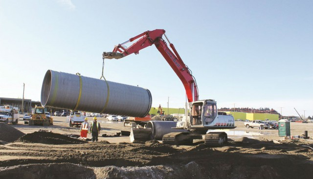 A 6-metre-long section of large diameter SaniTite HP pipe is moved into place. The polypropylene pipe provides the additional stiffness plus the long bell and dual gaskets needed to compensate for the area's soft soils.