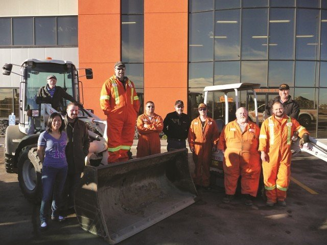Staff in front of the new Compact Rentals' facility .