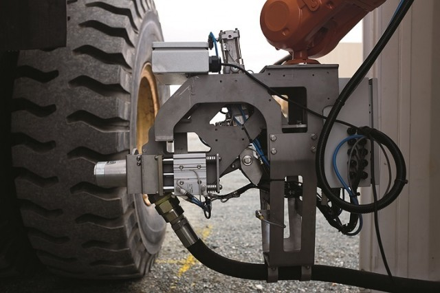 Western Global's automated fuel system uses a robotic arm to interact with haul trucks, allowing a worker to be redeployed for better efficiency.