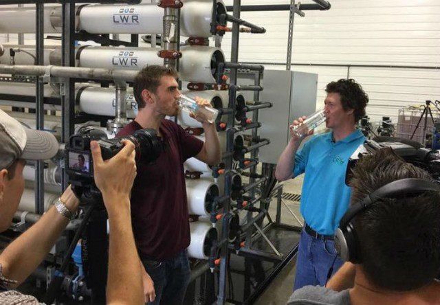 Gareth Jenkins, right, drinks clean water recently recycled from manure through the LWR System with The Water Brothers host, Alex Mifflin.