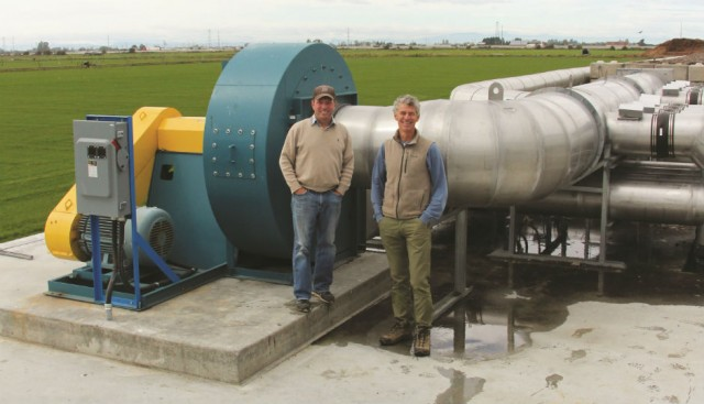Daryl Goodwin and Michael Bryan-Brown in front of Enviro-Smart Organics' newly installed reversing aeration and blower system.