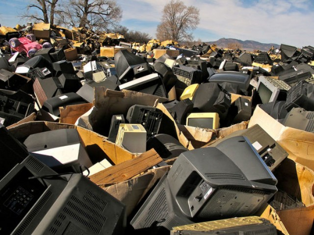 Gaylords of old TVs dumped by Stone Castle LLC, in Parowan, Utah. Copyright BAN 2014.