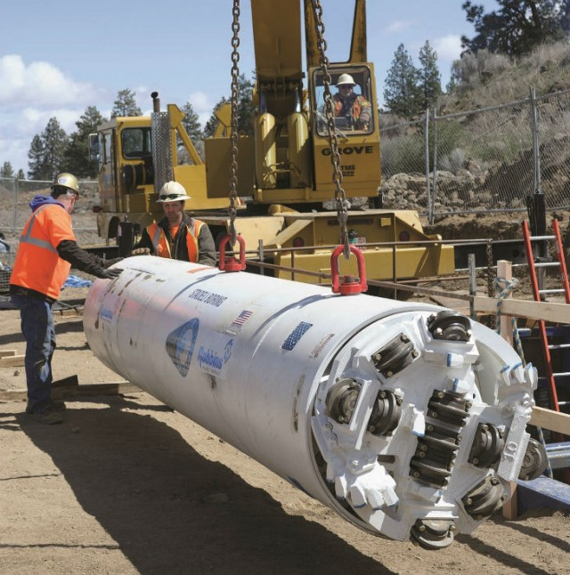 A prototype of the SBU-RC unit was tested at Bend, Oregon, where a general contractor needed to install 98 metres of 900-mm steel casing under railroad tracks, with close tolerances and in solid rock.