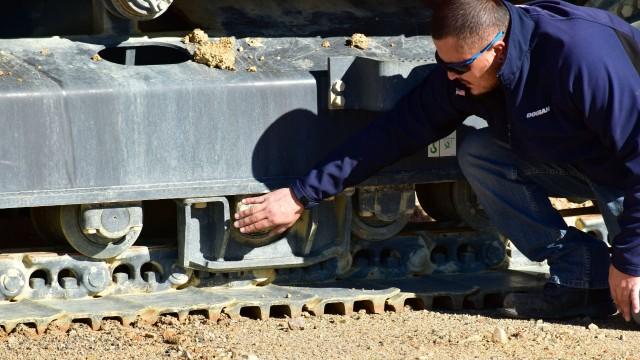 Inspecting material handler roller.